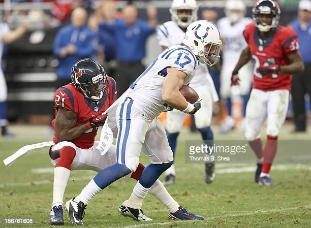 Griff Whalen of the Indianapolis Colts is tackled by Brice McCain of the Houston Texans on November 03 2013 at Reliant Stadium in Houston Texas Colts...