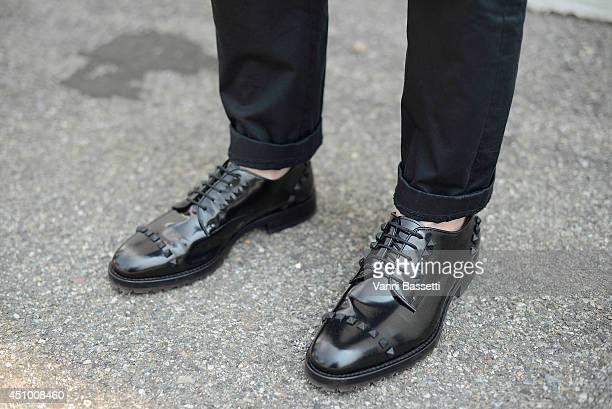 Griffin Chan is seen wearing Chris van Assche trousers and Valentino shoes on June 21, 2014 in Milan, Italy.