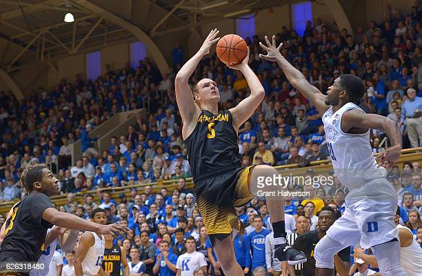 Griffin Kinney of the Appalachian State Mountaineers drives against Amile Jefferson of the Duke Blue Devils during the game at Cameron Indoor Stadium...