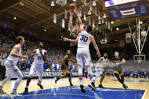 Griffin Kinney of the Appalachian State Mountaineers puts up a shot against Antonio Vrankovic of the Duke Blue Devils at Cameron Indoor Stadium on...