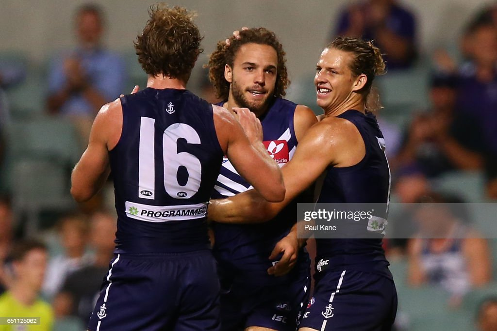 Griffin Logue of the Dockers is congratulated by David Mundy and Nathan Fyfe after kicking his first goal during the JLT Community Series AFL match between the Fremantle Dockers and the Carlton Blues at Domain Stadium on March 10, 2017 in Perth, Australia.