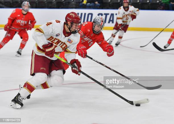 Griffin Mendel of the Denver Pioneers skates with the puck ahead of John Wiitala of the Ohio State Buckeyes during an NCAA Division I Men's Ice...