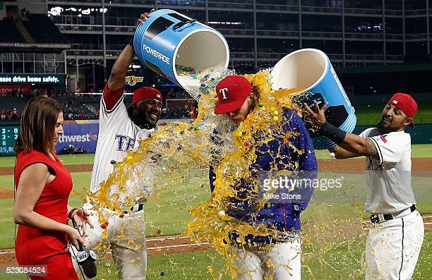 J Griffin of the Texas Rangers is doused with sports drink by Elvis Andrus and Rougned Odor after beating the Houston Astros at Globe Life Park in...