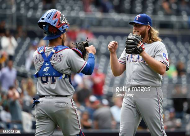 J Griffin of the Texas Rangers right is congratulated by Robinson Chirinos after beating the San Diego Padres 110 in a baseball game at PETCO Park on...