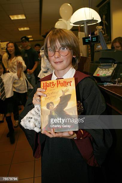 Griffin Prochter age 9 proudly displays the first copy of Harry Potter and the Deathly Hallows sold at the Barnes Noble bookstore on the Third Street...