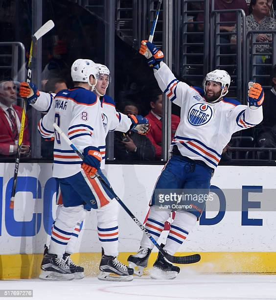 Griffin Reinhart Connor McDavid and Patrick Maroon of the Edmonton Oilers celebrate McDavid's first period goal against the Los Angeles Kings on...