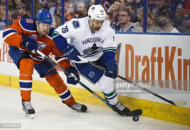 Griffin Reinhart of the Edmonton Oilers defends against Emerson Etem of the Vancouver Canucks on March 18 2016 at Rexall Place in Edmonton Alberta...