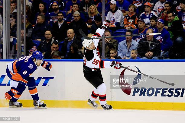 Griffin Reinhart of the New York Islanders loses his stick while trying to check Jacob Josefson of the New Jersey Devils in the first period during a...