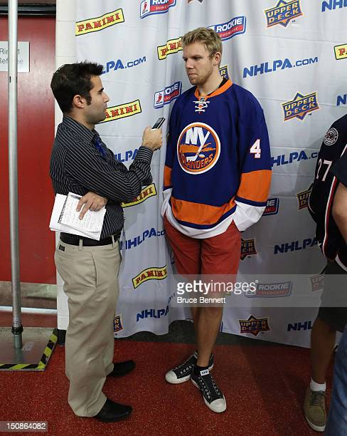 Griffin Reinhart of the New York Islanders meets with the media at the 2012 NHLPA rookie showcase at the MasterCard Centre on August 28 2012 in...