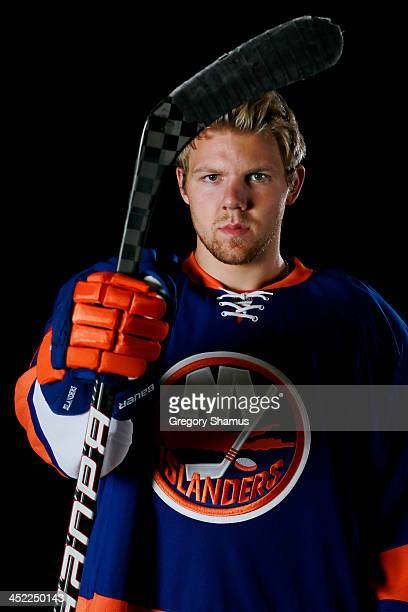 Griffin Reinhart of the New York Islanders poses for an NHLPA The Players Collection portrait at The Westin Harbour Castle hotel on August 27 2012 in...
