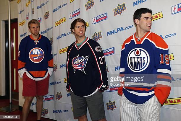 Griffin Reinhart of the New York Islanders Ryan Murray of the Columbus Blue Jackets and Justin Schultz of the Edmonton Oilers meet with the media at...