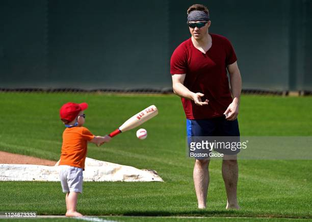 Griffin Wyatt Holt takes batting practice with his dad Boston Red Sox second baseman Brock Holt at Jet Blue Park in Fort Myers FL on Feb 12 2019...