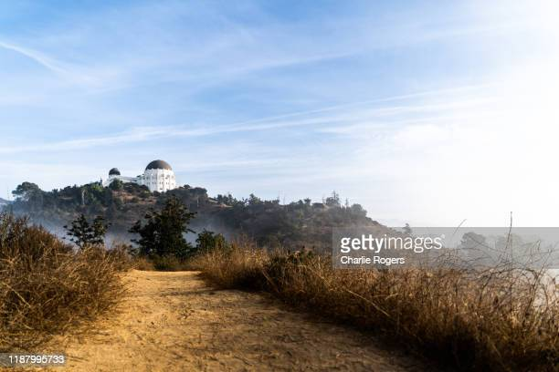 griffith park observatory trail at sunrise - griffith park stock pictures, royalty-free photos & images