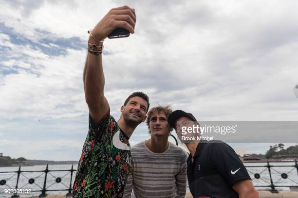 Grigor Dimitrov Alex Zverev and Lleyton Hewitt take a selfie during the Sydney Fast4 Media Opportunity at Hickson Road Reserve on January 8 2018 in...