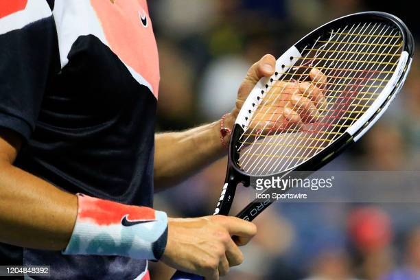 Grigor Dimitrov checks the broken strings on his tennis racket during the match on March 02, 2020 at Infinite Energy Arena in Duluth, GA.