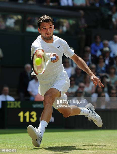 Grigor Dimitrov during his Quarter Final match against Andy Murray on Day Nine of the 2014 Wimbledon Tennis Championships at the All England Lawn...