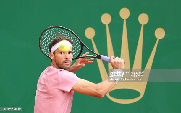 Grigor Dimitrov of Belarus plays a backhand shot during their Round 32 match against Jeremy Chardy of France during day four of the Rolex Monte-Carlo...