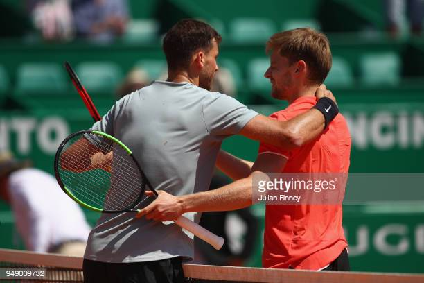 Grigor Dimitrov of Bulgaria and David Goffin of Belgium hug after their singles match during say six of ATP Masters Series Monte Carlo Rolex Masters...
