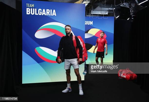 Grigor Dimitrov of Bulgaria and David Goffin of Belgium prepare to walk on court for their Group C singles match during day five of the 2020 Sydney...