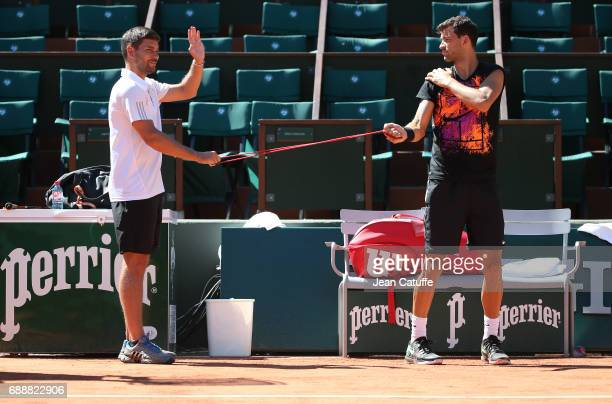 Grigor Dimitrov of Bulgaria and his coach Daniel Vallverdu during practice on Court Central two days ahead of the start of 2017 French Open at Roland...