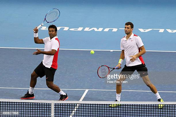 Grigor Dimitrov of Bulgaria and Leander Paes of India competes against Rameez Junaid of Australia and Jonathan Marray of Great Britain during the...