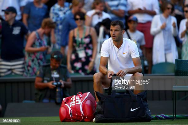 Grigor Dimitrov of Bulgaria appears dejected after being defeated by Stanislas Wawrinka of Switzerland during their Men's Singles first round match...