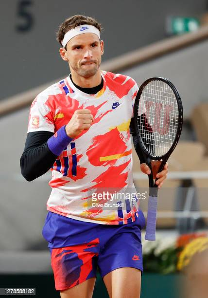 Grigor Dimitrov of Bulgaria celebrates after winning a point during his Men's Singles fourth round match against Stefanos Tsitsipas of Greece on day...
