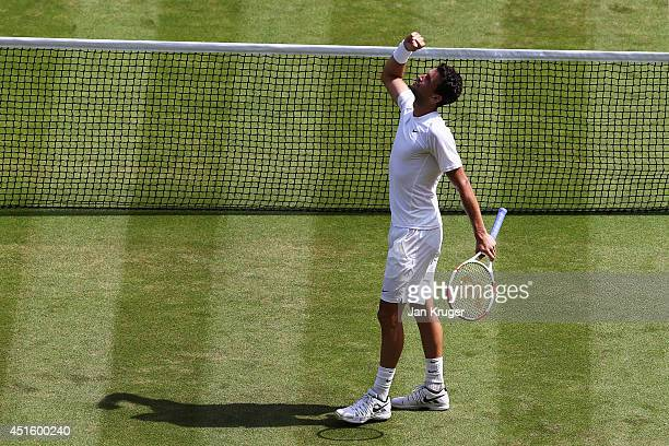 Grigor Dimitrov of Bulgaria celebrates after winning his Gentlemen's Singles quarterfinal match against Andy Murray of Great Britain on day nine of...