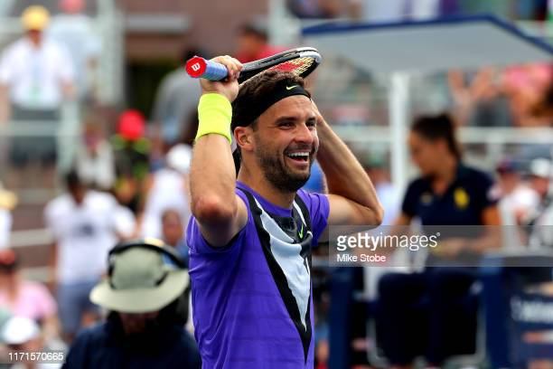 Grigor Dimitrov of Bulgaria celebrates after winning his Men's Singles fourth round match against Alex de Minaur of Australia on day seven of the...