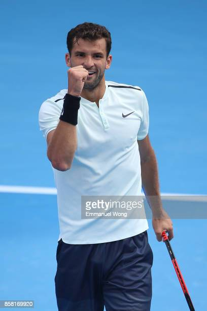 Grigor Dimitrov of Bulgaria celebrates after winning the Men's Quarterfinal match against Roberto Bautista Agut of Spain on day seven of the 2017...