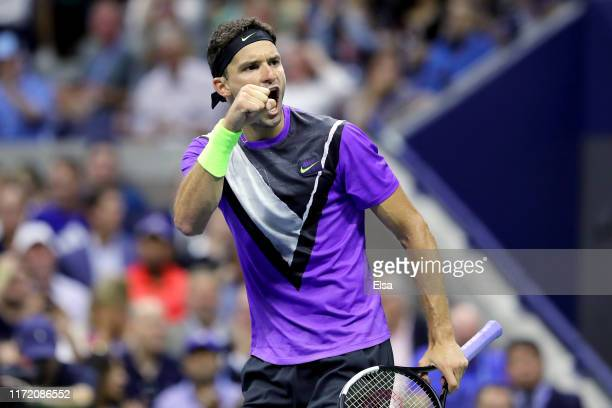 Grigor Dimitrov of Bulgaria celebrates after winning the second set during his Men's Singles quarterfinal match against Roger Federer of Switzerland...