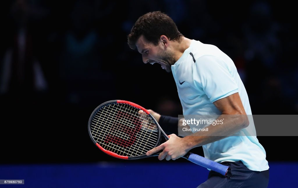 Grigor Dimitrov of Bulgaria celebrates match point against Jack Sock of the United States in their semi final match at the Nitto ATP World Tour Finals at O2 Arena on November 18, 2017 in London, England.