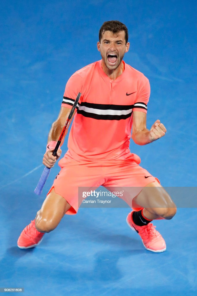 Grigor Dimitrov of Bulgaria celebrates match point in his fourth round match against Nick Kyrgios of Australia on day seven of the 2018 Australian Open at Melbourne Park on January 21, 2018 in Melbourne, Australia.
