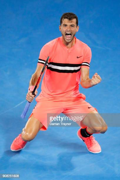 Grigor Dimitrov of Bulgaria celebrates match point in his fourth round match against Nick Kyrgios of Australia on day seven of the 2018 Australian...
