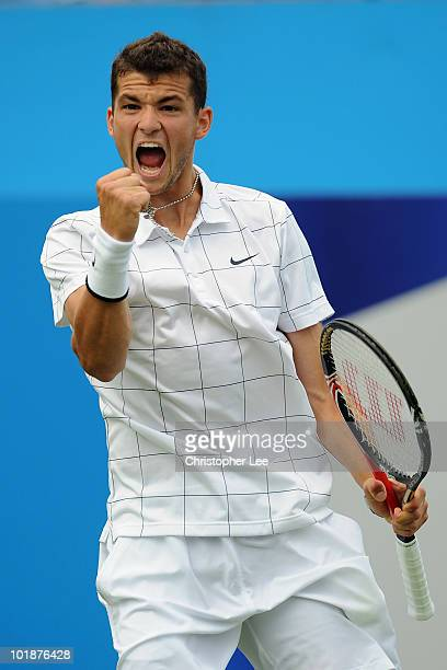 Grigor Dimitrov of Bulgaria celebrates taking match point during the men's first round match against Alex Bogdanovic of Great Britain on Day 2 of the...