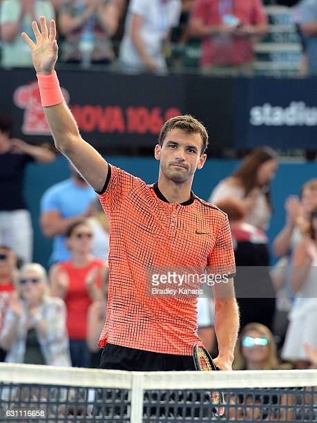 Grigor Dimitrov of Bulgaria celebrates victory against Milos Raonic of Canada after their semi final match on day seven of the 2017 Brisbane...