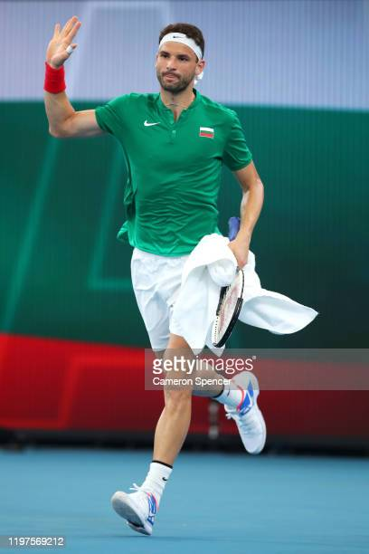 Grigor Dimitrov of Bulgaria celebrates winning his Group C singles match against Radu Albot of Moldova during day three of the 2020 ATP Cup Group...