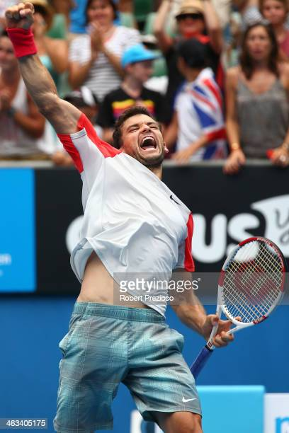 Grigor Dimitrov of Bulgaria celebrates winning his third round match against Milos Raonic of Canada during day six of the 2014 Australian Open at...