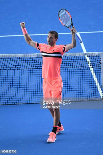 Grigor Dimitrov of Bulgaria celebrates winning his third round match against Andrey Rublev of Russia on day five of the 2018 Australian Open at...