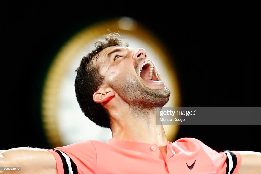 Grigor Dimitrov of Bulgaria celebrates winning in his fourth round match against Nick Kyrgios of Australia on day seven of the 2018 Australian Open at Melbourne Park on January 21, 2018 in Melbourne, Australia.