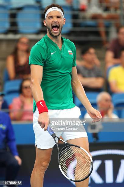 Grigor Dimitrov of Bulgaria celebrates winning match point during his Group C singles match against Radu Albot of Moldova during day three of the...
