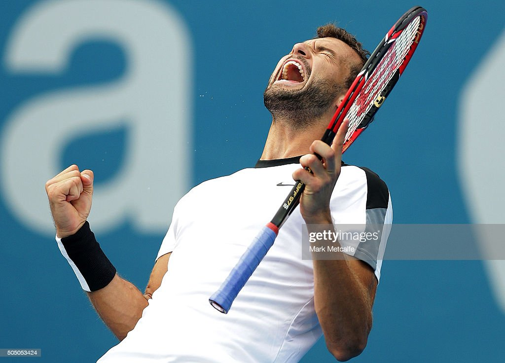 Grigor Dimitrov of Bulgaria celebrates winning match point in his semi final match against Gilles Muller of Luxembourg during day six of the 2016 Sydney International at Sydney Olympic Park Tennis Centre on January 15, 2016 in Sydney, Australia.