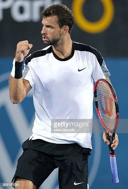 Grigor Dimitrov of Bulgaria celebrates winning set point in his men's final match against Viktor Troiki of Serbia during day seven of the 2016 Sydney...