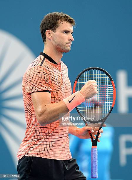 Grigor Dimitrov of Bulgaria celebrates winning the first set against Milos Raonic of Canada during their semi final match on day seven of the 2017...