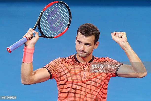 Grigor Dimitrov of Bulgaria celebrates winning the Men's Final against Kei Nishikori of Japan during day eight of the Brisbane international at Pat...
