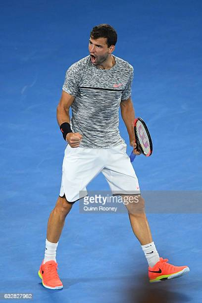 Grigor Dimitrov of Bulgaria celebrates winning the second set in his semifinal match against Rafael Nadal of Spain on day 12 of the 2017 Australian...