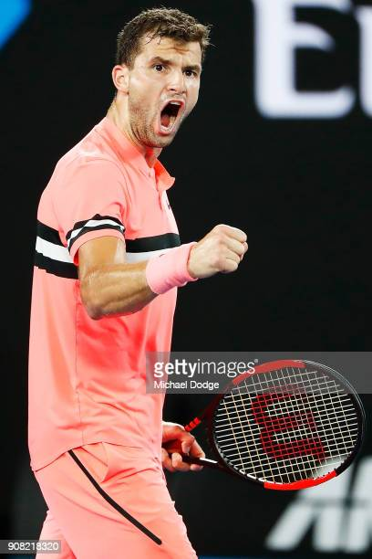 Grigor Dimitrov of Bulgaria celebrates winning the second set in his fourth round match against Nick Kyrgios of Australia on day seven of the 2018...