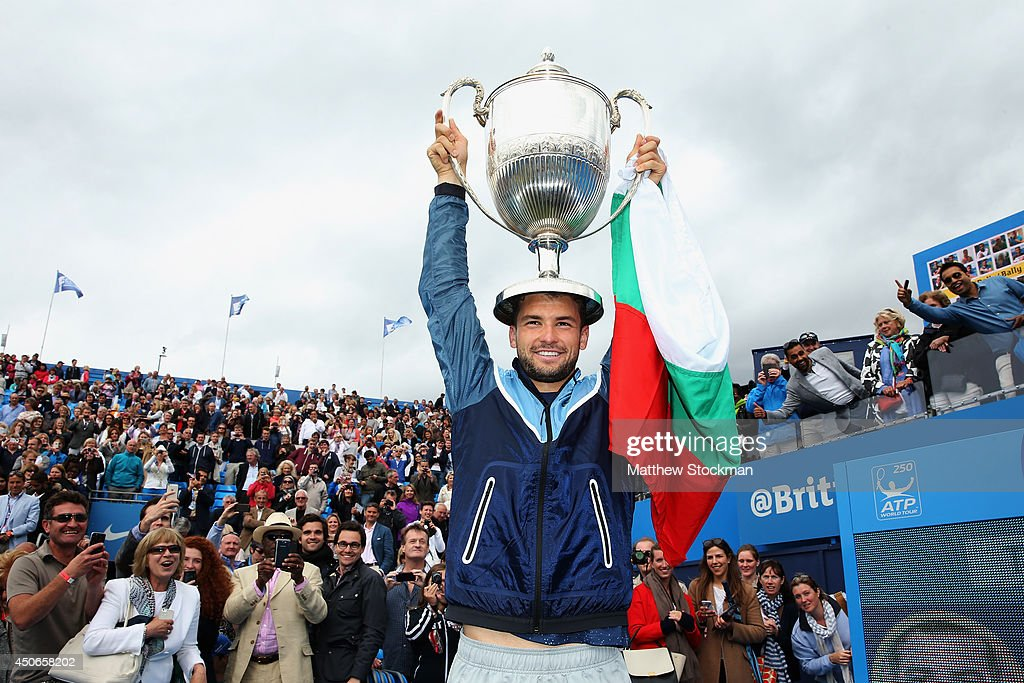Grigor Dimitrov of Bulgaria celebrates with the winners trophy after defeating Feliciano Lopez of Spain during their Men's Singles Final on day seven of the Aegon Championships at Queens Club on June 15, 2014 in London, England.