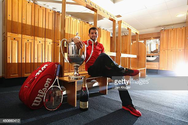 Grigor Dimitrov of Bulgaria celebrates with the winners trophy in the players changing room after defeating Feliciano Lopez of Spain during their...
