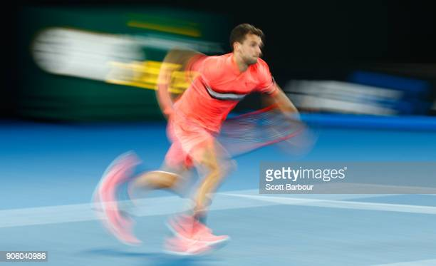Grigor Dimitrov of Bulgaria chases the ball in his second round match against Mackenzie McDonald of the United States on day three of the 2018...